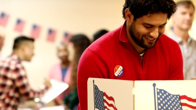 Mid-adult, Latin descent man votes in USA election. video
