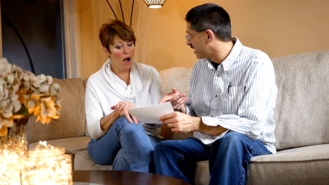 middle aged couple is happy about their tax return alt - reso video stock e b–roll