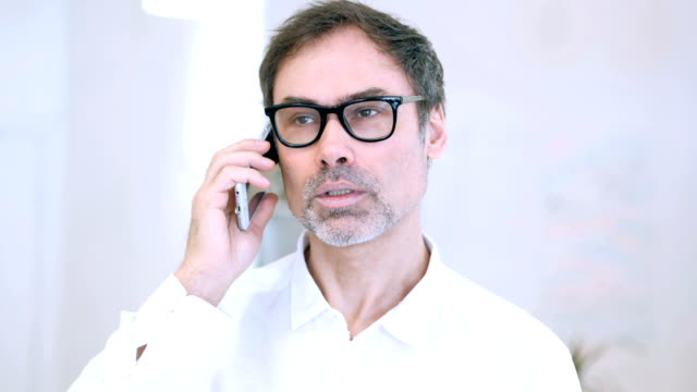 Middle Aged Man Talking on Phone, Attending Phone Call video