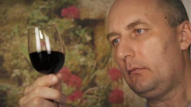 Middle aged tester with glass of red wine video