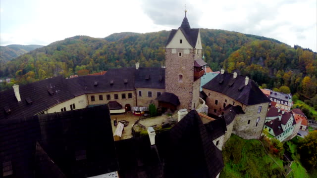 Middle ages Castle town aerial shot, colorful roofs, kings court. Beautiful aerial shot above Europe, culture and landscapes, camera pan dolly in the air. Drone flying above European land. Traveling sightseeing, tourist views of Czech Republic. video
