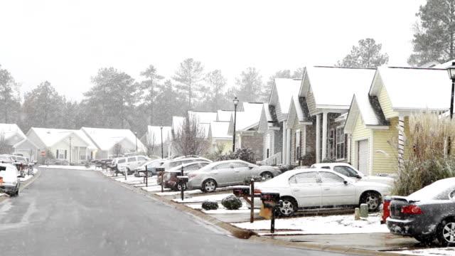 middle class american subdivision snow day - cold street bildbanksvideor och videomaterial från bakom kulisserna
