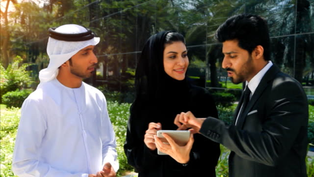 Middle Eastern Businessmen and Businesswoman working with Digital Tablet Outdoor video