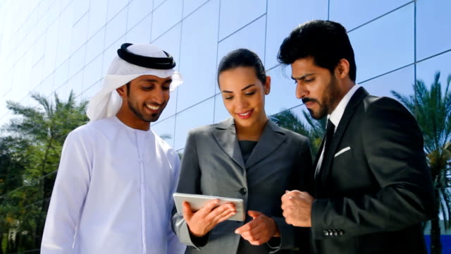 middle eastern businessmen and businesswoman working with digital tablet outdoor - emirati woman 個影片檔及 b 捲影像