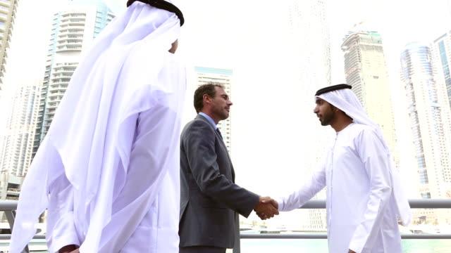 middle eastern businessmen meeting western man - stock video - arab стоковые видео и кадры b-roll