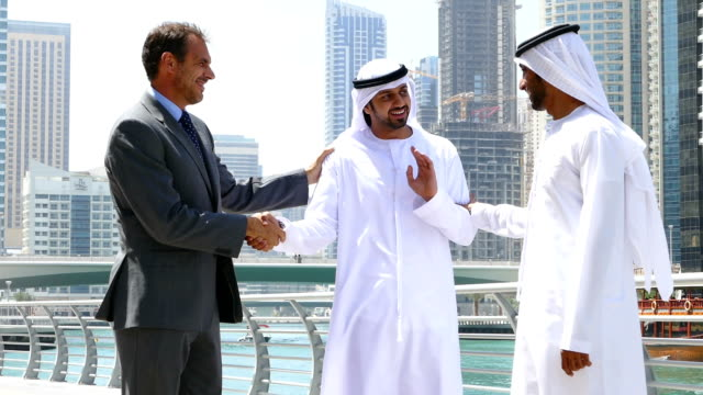 Middle eastern businessmen talking with western man video