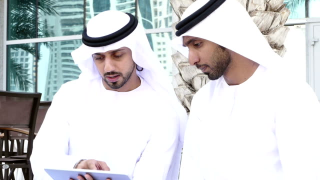 middle eastern mans with digital tablet outdoor - arabia saudita video stock e b–roll