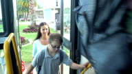 istock Middle school class boarding bus, boy with down syndrome 1208301267
