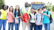 istock Middle school students, crossing guard, boy with downs 1208293881