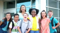 istock Middle school teacher, students, boy with down syndrome 1208308328