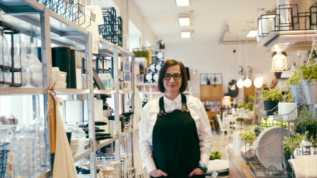 Middle-aged business owner in a home decor shop, portrait video