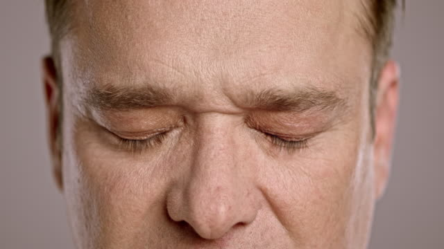 Middle-aged Caucasian man opening his eyes