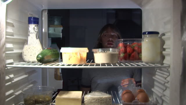 Midnight Feast - From Inside Refrigerator HD & PAL Stock video clip footage of a man having a midnight feast after checking the coast is clear! Tripod fridge stock videos & royalty-free footage