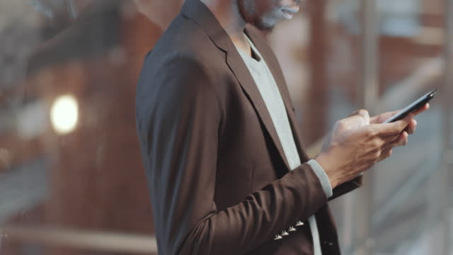 Midsection of African American Businessman Using Smartphone in Office