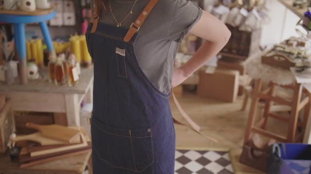 Midsection Of Small Business Owner Wearing Denim Apron In Store video