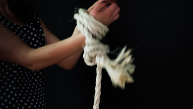 Midsection Of Woman Tied Up With Rope video
