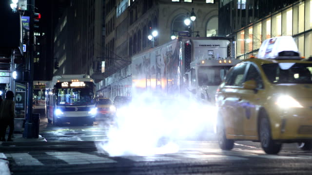 midtown manhattan night traffic - bus stock videos and b-roll footage
