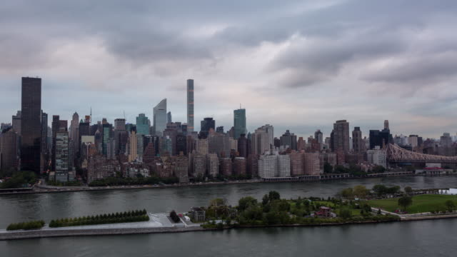 Midtown Manhattan Skyline and East River Day to Night Sunset Timelapse video