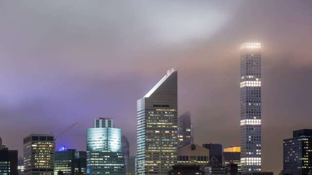 Midtown Manhattan Skyline Buildings with Clouds Night Timelapse video