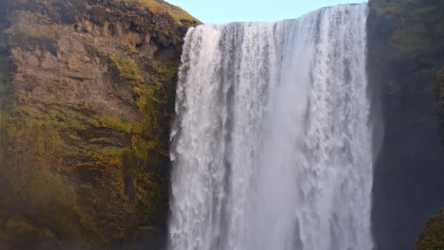 slo mo td mighty skogafoss waterfall in iceland - tilt down stock videos & royalty-free footage