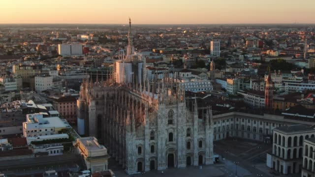milan cathedral aerial view drone at sunrise milan cathedral duomo aerial view drone at sunrise,shot of city center at dawn cathedrals stock videos & royalty-free footage