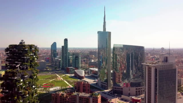 milan, italy - september 26, 2018: milan city skyline aerial view flying towards financial area skyscrapers - italian architecture stock videos & royalty-free footage