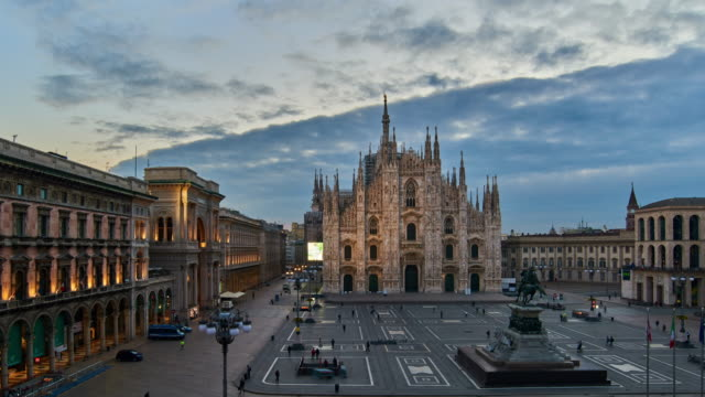 4K: Milan Piazza Del Duomo and Duomo Di Milano, Italy, Dawn to Sunrise Time lapse Milan Piazza Del Duomo and Duomo Di Milano, Milan, Italy, Dawn to Sunrise Time lapse - Zoom Out. lombardy stock videos & royalty-free footage