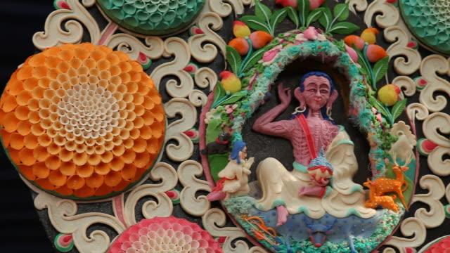 Milarepa butter sculpture at Tibetan temple in India video