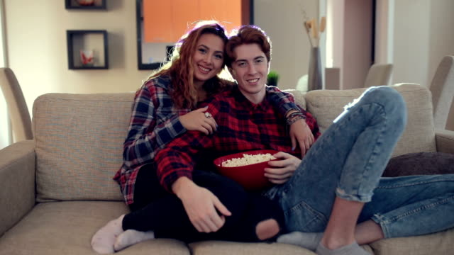 Milennials wathcing movie at home Real red haired couple is watching movies at home on a projector . They are real couple so emotion is real and candid . 23 year old students heterosexual couple stock videos & royalty-free footage