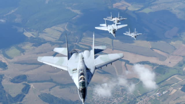 Milirary Airplanes Flight in Formation. Mikoyan Gurevich MiG-29 Fulcrum of Bulgarian and Polish Air Force Air to Air 4K