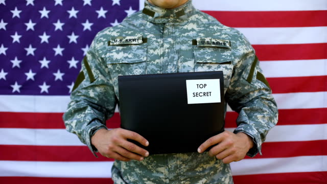 Military agent holding top secret folder, government agency, national security Military agent holding top secret folder, government agency, national security police meeting stock videos & royalty-free footage