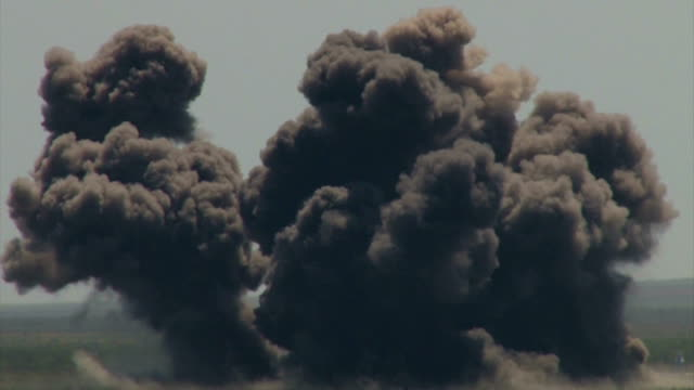 Bидео military aircraft bombing ground targets