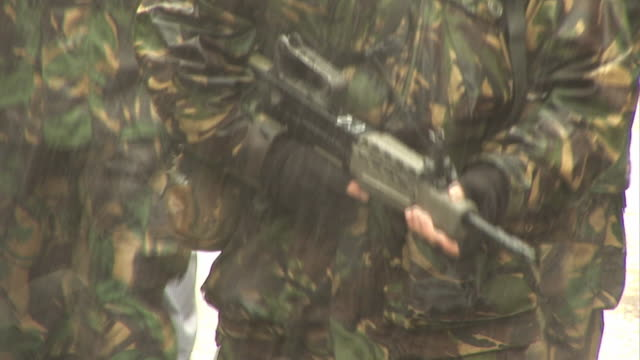 Military Army Soldiers in Camouflage with Guns walking or marching video