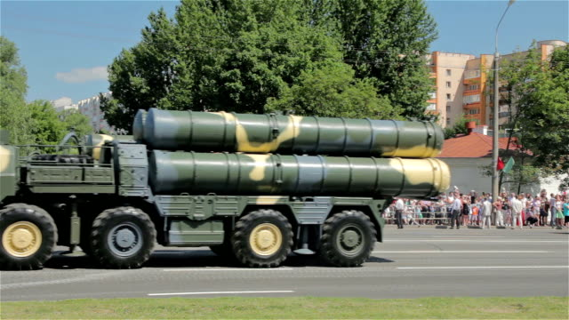 Military cars with missiles go on the street video