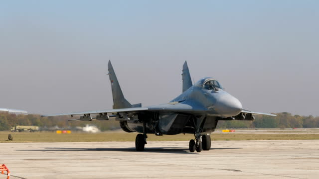 Military Combat Jet Aircraft MiG 29 Fulcrum of Serbian Air Force Taxiing Military Combat Jet Aircraft MiG 29 Fulcrum of Serbian Air Force Taxiing to the Parking with High Quality Original Audio. Sloboda (Freedom) 2017 Second World War Victory Anniversary at Batajnica Air Base Belgrade Serbia 20 October 2017 airfield stock videos & royalty-free footage