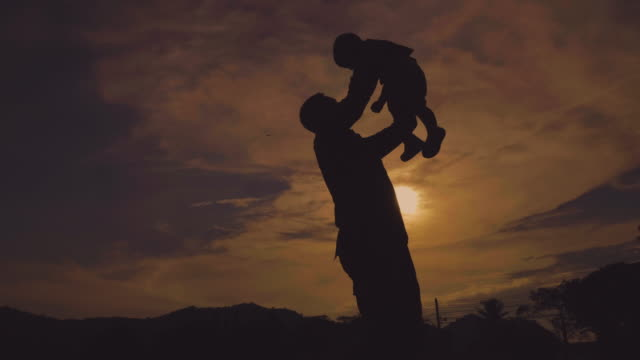 military father embraces his son in park - military lifestyle stock videos & royalty-free footage