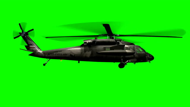 Military Helicopter Black Hawk in flight - green screen