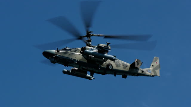 military helicopter hovering in the sky video