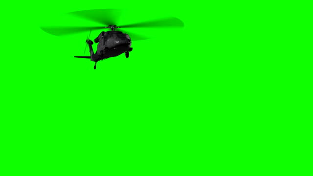 military helicopter in flight on green screen - helikopter filmów i materiałów b-roll
