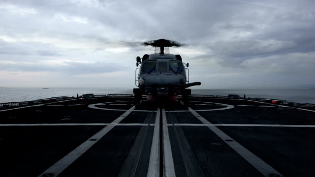 Military helicopter standby in a battleship video