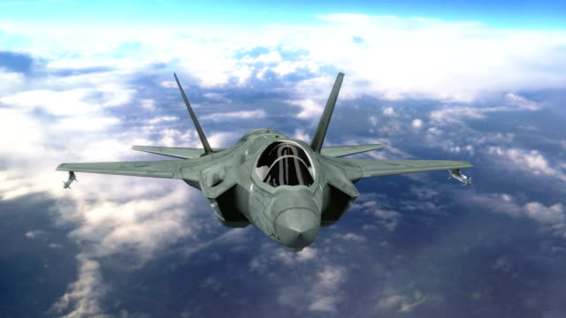 Military jet aircraft flying above clouds video