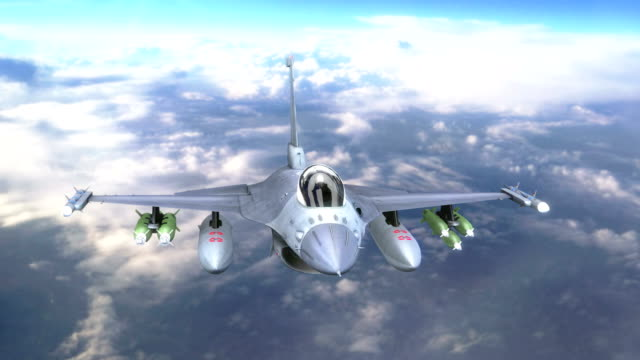 F-16 military jet flying above the clouds video