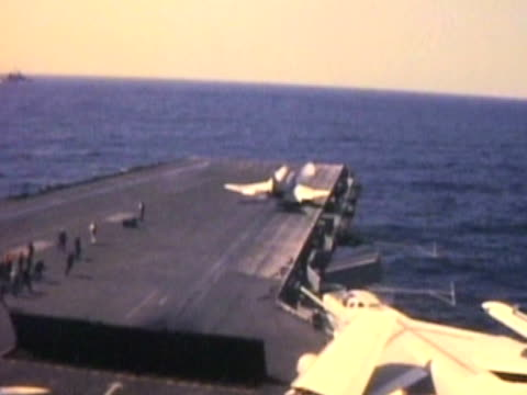 Military jet takes off--From 1960's film video
