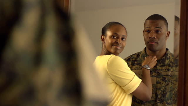 Military Man and Wife in Mirror Military man and wife in mirror expressing positivity, pride, and love. wife stock videos & royalty-free footage