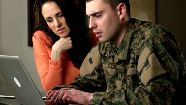 Military Man and Woman Interact with Laptop Computer video