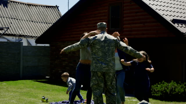 military man returning home to family - military lifestyle stock videos & royalty-free footage