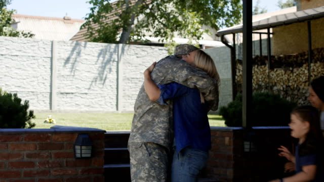 Military man returning home to family Cheerful woman with children welcoming father and husband from military service looking super excited homecoming stock videos & royalty-free footage