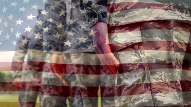 Military men in uniform and the American flag Digital composite of military men in uniform while American flag waves in the background military uniform stock videos & royalty-free footage