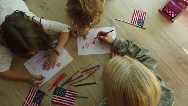 4k: military mom coloring with her kids. - military lifestyle stock videos & royalty-free footage