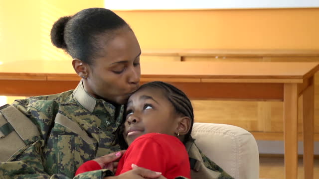 Military Mother Embraces and Kisses Her Daughter video